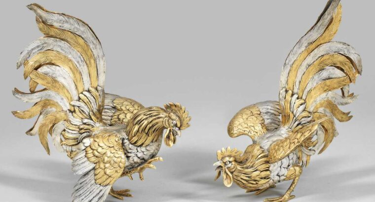 "Elegant Pair of sculptures ""fighting cocks"""